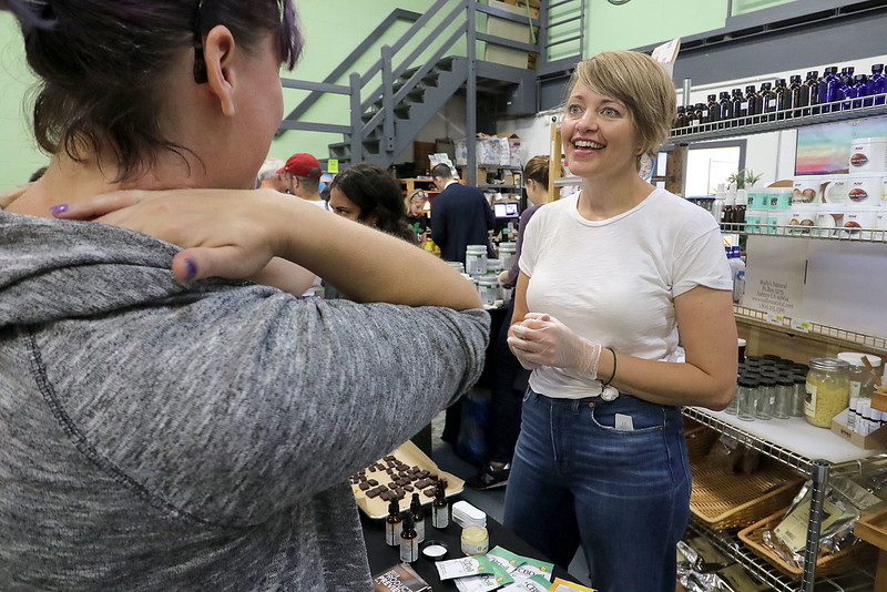Roots Market, Kitchen, Juice Bar and Yoga held its Rootsfest 2018 on Saturday, September 8, 2018 in Leominster. Kristin Jorgenson a sales rep for DBD oil out of San Diegio California talks to customers about the oil at the festival. CBD or cannabidiol is a phytocannabinoid found in agricultural hemp. SENTINEL & ENTERPRISE/JOHN LOVE