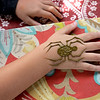 Roots Market, Kitchen, Juice Bar and Yoga held its Rootsfest 2018 on Saturday, September 8, 2018 in Leominster. Dominic Sanchez, 6, of Worcester gets some henna in the shape of a spider from Mandy Roberge of Wicked Good Henna at her booth during the festival. SENTINEL & ENTERPRISE/JOHN LOVE