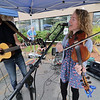 Roots Market, Kitchen, Juice Bar and Yoga held its Rootsfest 2018 on Saturday, September 8, 2018 in Leominster. Scott Heron and Betsy Heron with the group Green Heron entertain the crowd at the festival. SENTINEL & ENTERPRISE/JOHN LOVE