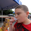 Roots Market, Kitchen, Juice Bar and Yoga held its Rootsfest 2018 on Saturday, September 8, 2018 in Leominster. Alexander Pagan, 13, of Fitchburg tries the drink Honey Rose from the Gold Thread booth at the festival. SENTINEL & ENTERPRISE/JOHN LOVE