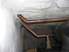 28mm pipework from back boiler on back of woodburner.  Drain cock on lower return as this is lowest point