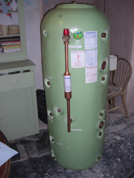 The new 215l thermal store, tapping points for CH and  woodburner fow/return. Coils for mains HW, boiler (not used) and solar. Plus two immersion bosses.  There's so much copper in there I'm not sure there's room for any water...