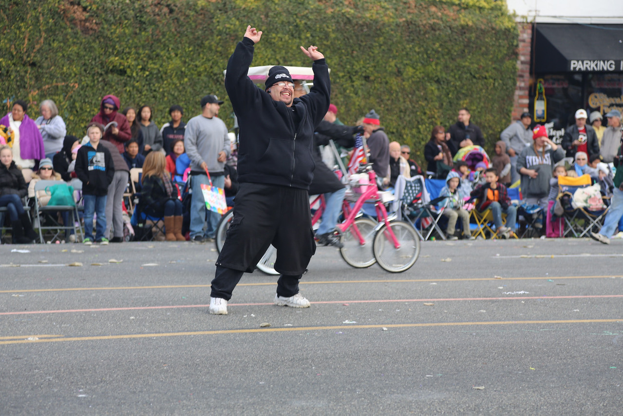 """Whacko from across the street kept trying to whip the crowd into a frenzy by yelling """"Happy New Year!""""  to the people in the bleachers as loud as he could."""