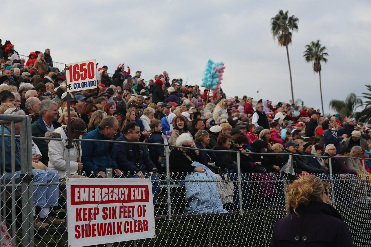 Grandstand in front of Pasadena City College.  Tickets are $100.  I prefer to stand on the street, closer to the action.