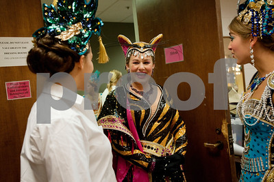 photo by Sarah A. Miller/Tyler Morning Telegraph  Lady-in-waiting Ashley Brown, 19, of Tyler, center, wears her Bengal Tiger gown backstage at the 2012 Texas Rose Festival Coronation matinee performance Friday afternoon at the University of Texas at Tyler Cowan Center. The theme of the festival was Indochine.
