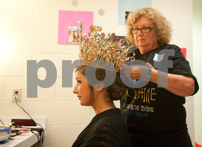 photo by Sarah A. Miller/Tyler Morning Telegraph  Hair stylist Jean Moshier of Tyler pins the crown Rose Queen Haley McGrede Anderson's head backstage at the 2012 Texas Rose Festival Coronation matinee performance Friday afternoon at the University of Texas at Tyler Cowan Center. The theme of the festival was Indochine.