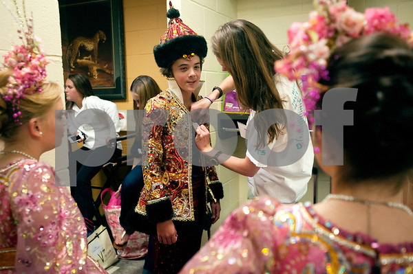 photo by Sarah A. Miller/Tyler Morning Telegraph  Scepter bearer Garrett Gowin gets dressed backstage at the 2012 Texas Rose Festival Coronation matinee performance Friday afternoon at the University of Texas at Tyler Cowan Center. The theme of the festival was Indochine.