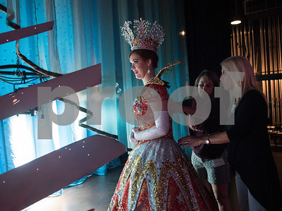 Misty Wages and Deanne Gabriel make an adjustment to Rose Queen Emily Evans' elaborate dress backstage during rehearsal for the Queen's Coronation Thursday Oct. 19, 2017 at the Cowan Center in Tyler.  (Sarah A. Miller/Tyler Morning Telegraph)