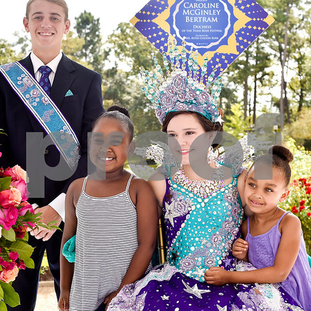 Escort Ritter Kerr, Anorah Mast, 7, duchess Caroline Bertram and Andrea Mast, 5, during the 84th Texas Rose Festival Queen's Tea at the Tyler Rose Garden in Tyler, Texas, on Saturday, Oct. 21, 2017. All the ladies and their escorts were in their full dress attire on the garden grounds to take photos with the community. (Chelsea Purgahn/Tyler Morning Telegraph)