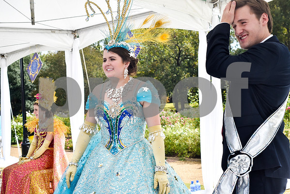Lady-in-waiting Claire Stratton and escort William Coates chat with people  during the 84th Texas Rose Festival Queen's Tea at the Tyler Rose Garden in Tyler, Texas, on Saturday, Oct. 21, 2017. All the ladies and their escorts were in their full dress attire on the garden grounds to take photos with the community. (Chelsea Purgahn/Tyler Morning Telegraph)