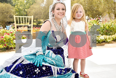 Lauren Lyons poses for a photo with Tilly Dawson, 3 1/2, during the 84th Texas Rose Festival Queen's Tea at the Tyler Rose Garden in Tyler, Texas, on Saturday, Oct. 21, 2017. All the ladies and their escorts were in their full dress attire on the garden grounds to take photos with the community. (Chelsea Purgahn/Tyler Morning Telegraph)