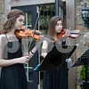 Sisters Josephine Coward, 15, and Isabella Coward, 17, of Longview, play music for the opening ceremony of the 59th Azalea & Spring Flower Trail in Tyler, Texas on Friday March 16, 2018. The trail is a three-week that draws tourists who come to see azaleas and other flowers grown in yards around Tyler's Azalea District neighborhood.<br /> <br /> (Sarah A. Miller/Tyler Morning Telegraph)
