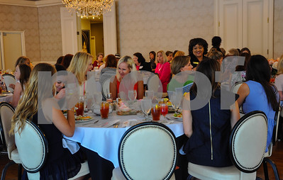 Guests share a laugh during the Friends of the Rose luncheon held at willow Brook Country Club in Tyler on Wednesday, July 11. (Jessica T. Payne/Tyler Paper)