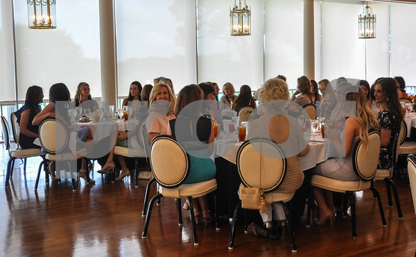"""Participants of the 85th Texas Rose Festival along with their mothers and Friends of the Rose members enjoy a luncheon held during practice week for the Festival. This year's Texas Rose Festival theme is """"Rock the Rose"""" and will be held October 18-21. (Jessica T. Payne/Tyler Paper)"""