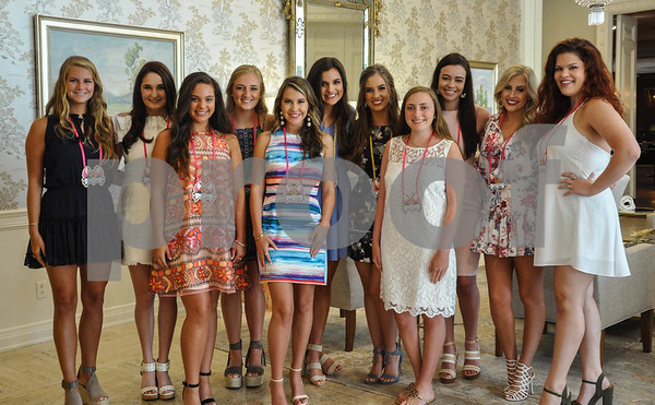 Ladies-in-Waiting pose for a photo with Queen of the Texas Rose Festival Amanda Elaine Hiles and Duchess of the Texas Rose Festival Ann Caswell Ferguson (both center back) at the Friends of the Rose luncheon held at the Willow Brook Country Club on Wednesday, July 11. (Jessica T. Payne/Tyler Paper)