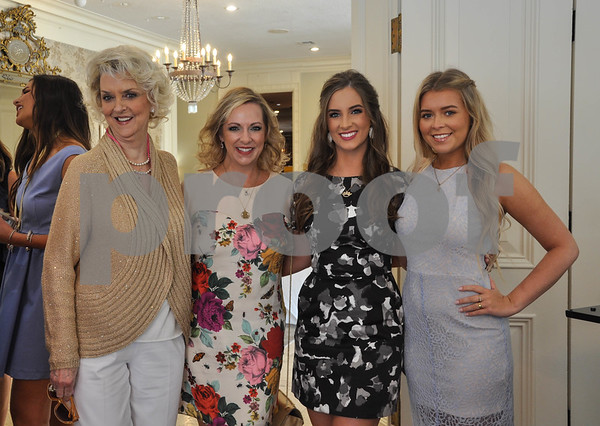 (From left to right) Ann Hardin, Stacey Hiles, Queen of the 85th Texas Rose Festival Amanda Elaine Hiles and Grace Hiles smile for a photo prior to the Friends of the Rose luncheon held at Willow Brook Country Club on Wednesday, July 11. (Jessica T. Payne/Tyler Paper)