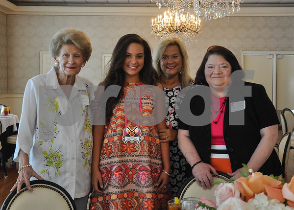 (From left to right) Martha Stewart, Hanna Maynard, Lynette Maynard and Janie Stewart stop for a photo at the Friends of the Rose luncheon on Wednesday, June 11. The event was held at the Willow Brook Country Club to welcome participants to practice week for the Texas Rose Festival. (Jessica T. Payne/Tyler Paper)
