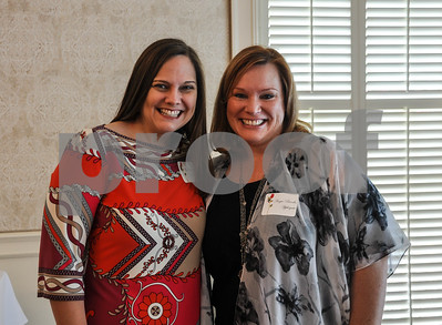 Lori Brooks Carver (left) and Angie Brooks Applegate (right) are all smiles at the Friends of the Rose luncheon on Wednesday, June 11. The event was held at the Willow Brook Country Club to welcome participants to practice week for the Texas Rose Festival. (Jessica T. Payne/Tyler Paper)