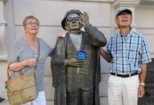 Pat and Will Chong with Friend Looking at Nobel Museum in Stockholm, Sweden