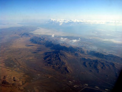 Salt Lake City is bounded by salt flats, mountains and lakes.