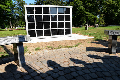 Tania Barricklo-Daily Freeman                       The newly completed Columbarium, a place to put cremation remains of veterans and their wives or husbands at the  Rosendale Plains Cemetary.The shadows of living veterans can be seen cast below.