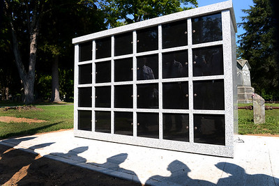 Tania Barricklo-Daily Freeman                       The newly completed Columbarium, a place to put cremation remains of veterans and their wives or husbands at the  Rosendale Plains Cemetary.The shadows and reflection of living veterans can be seen.