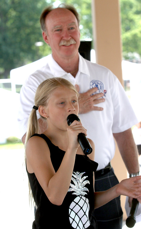 . Brooke Pozzi sings the National Anthem with Mayor Robert Taylor.