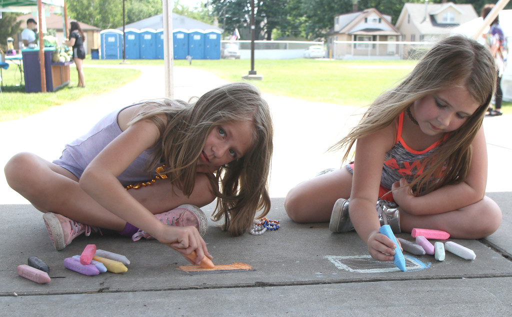 . Ashley and Miley Barber try their hand at chalk art.