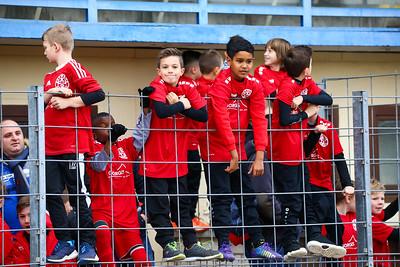 Players escort kids climbing on a fence; Rot-Weiß Koblenz - Eintracht Trier (1:1) in Stadion Oberwerth, Koblenz; 25.11.18, Photo: Jan von Uxkull-Gyllenband