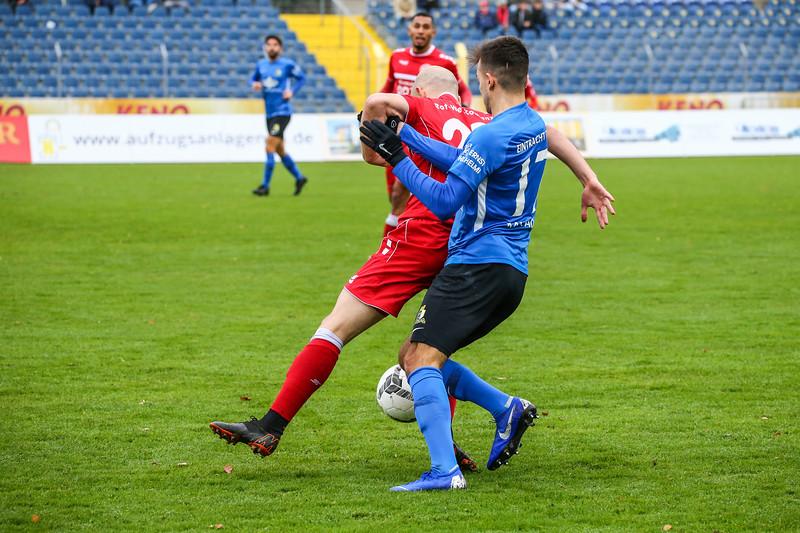 Jan Brandscheid (Eintracht Trier), Giuliano Masala (Rot-Weiß Koblenz); Rot-Weiß Koblenz - Eintracht Trier (1:1) in Stadion Oberwerth, Koblenz; 25.11.18, Photo: Jan von Uxkull-Gyllenband