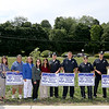 """The Leominster Rotary Club has made up some """"Thank You"""" lawn signs for anyone that want to support the local police. From left, with the signs, is Rotary members Frank Ardinger, Nikki Paglieroni, John Souza, Past President Claire Freda, Club President Jennifer Stacy, Bharti Bhakta, with police officers Michael Booth, Eric Craig, John Bouchard and Billy Taylor. On the right is Rotary members Mary Dean and Victor Bhakta. SENTINEL & ENTERPRISE/JOHN LOVE"""