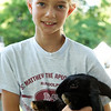 George Zacieracha's daughter and Blackie the rabbit - Rotary District 7470 at Camp Merry Heart - ©David Shapiro 2011