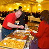 Matteo Ielemo of Pomodoro in Morristown serving a guest - Taste of Morristown at the Hanover Marriott in Whippany, NJ - Photo by David Shapiro