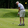 Past Morristown Rotary President Rusty Schommer on the practice green