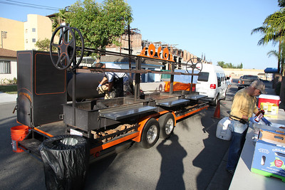 Orange County Optimists' new barbecue wagon with 3 large charcoal grills was driven over by Jesse James.
