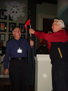 ISFR outgoing President Don Goering presents the symbol of office to incoming ISFR President Esio Marzotto. Photo courtesy of Marilyn Branch