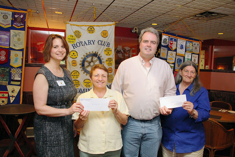 Rotary Club of Leominster recently held a wine dinner as a fundraiser for Samoset and Sky View middle schools and on Monday they where able to give each school a $2,000 check for their band programs. Pictured is, from left, Rotary President Mary Dean, Sky View band director Bernadette Marso, Samoset band director Bob Landry and past Rotary President Claire Freda. SENTINEL & ENTERPRISE/JOHN LOVE