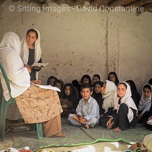 Schoolgirl & teacher – Jalalabad. May 2006