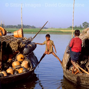 Boy between Boats - Savar, Bangladesh. February 1991