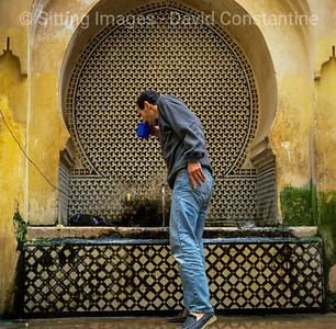 Man at drinking fountain, Fez, Morocco © David Constantine/Axiom