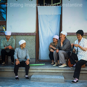 Muslim women chatting - China. May 2006