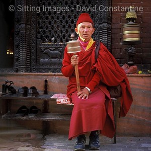 Monk with spinning prayer wheel, Boudanath stupa, Nepal © David Constantine/Axiom