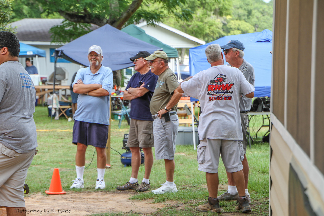 John, the owner of the track, with his back to the camera, discussing track conditions with some members of the Villages RC car club.