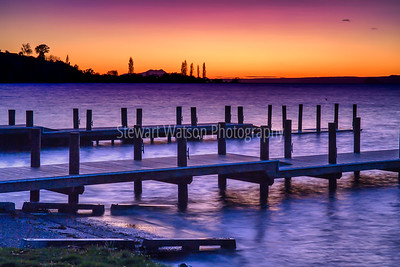 Dramatic colours of pre dawn over the piers and jetty at Turangi Lake Taupo New Zealand