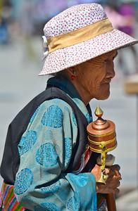 Tibetan woman with her prayer wheel