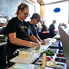 Route 38 or Main Street in Tewksbury has had some upgrades made to the development along the Route Recently. Pushcart Cafe at 1777 Main Street  reopened this March after being closed for 2 years. Hannah Culwell, 22, and Paige Small, 20, work on some sandwiches for customers at the cafe on Friday afternoon. SUN//JOHN LOVE