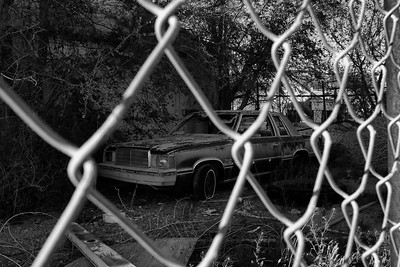 Old car behind fence