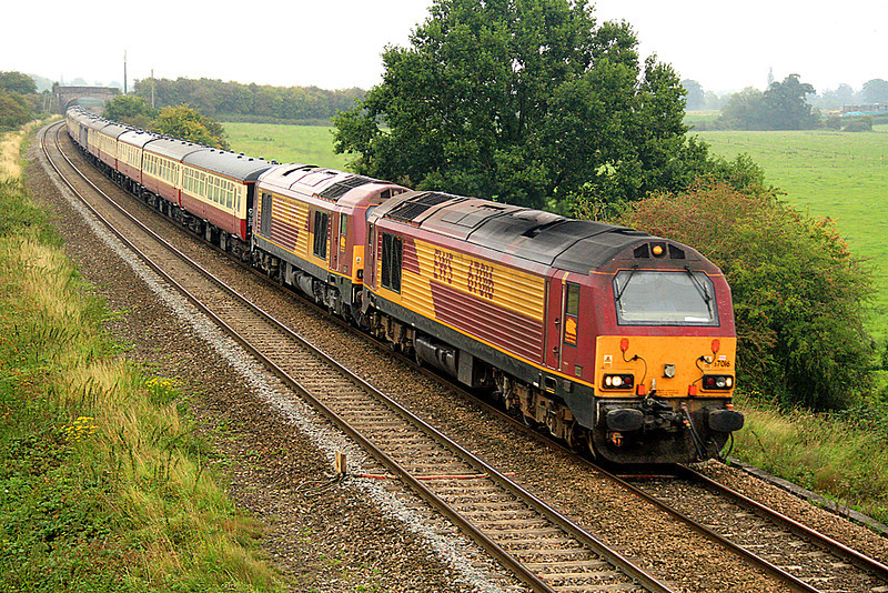 On a damp and misty autumn morning, 67016 and 67002 pass Berkley Marsh, east of Frome, with a Paddington to Par charter for a variety of Cornish attractions including the Bodmin and Wenford Steam Gala.  30/09/11.