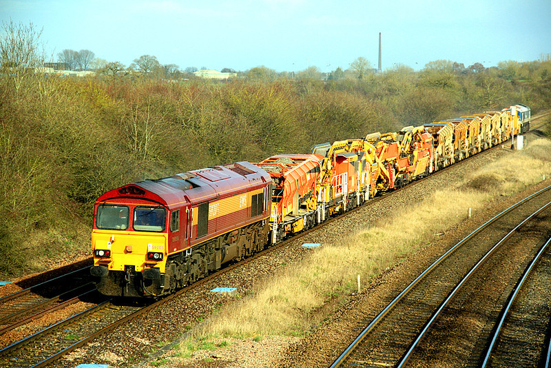 59205 approaches Fairwood Junction, Westbury, with a 'High Output Ballast Cleaner' set heading for the East Somerset Branch on 3 March, 2012.  Despite the sun, it was raining hard at the time!
