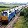 47709 passes Berkley Marsh, east of Frome, with a 'Blue Pullman' charter from Paddington to Paignton. 01/07/06.